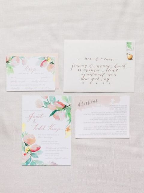 a beautiful watercolor floral wedding invitation suite in peachy, red and pink is a very romantic option