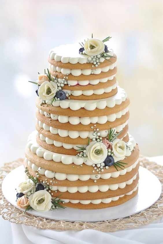 an elegant cookie wedding cake decorated with sugar blooms, greenery and edible beads for a more formal wedding