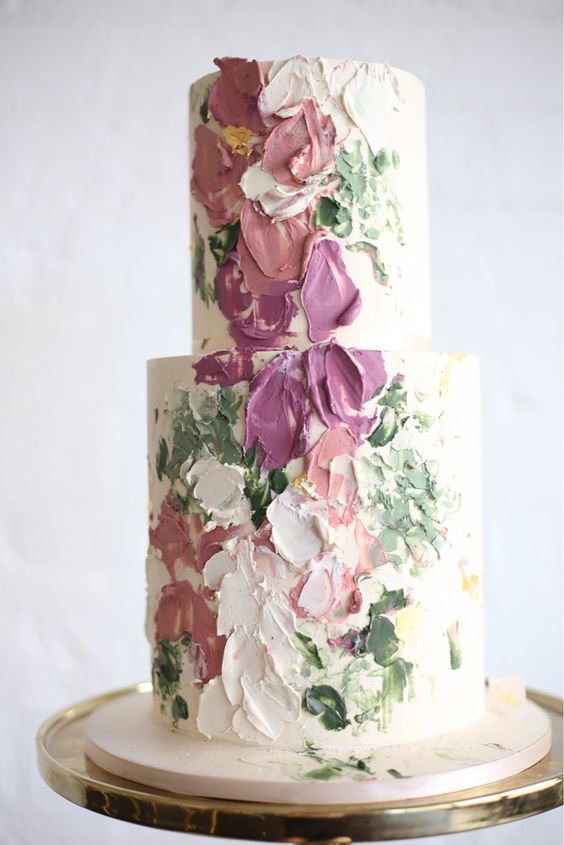 a jaw-dropping brushstroke flower wedding cake is a beautiful dessert inspired by Impressionist artworks