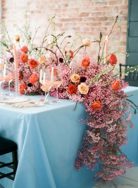 a luxurious pink baby's breath table runner with bright blooms and twigs is a very beautiful idea to rock
