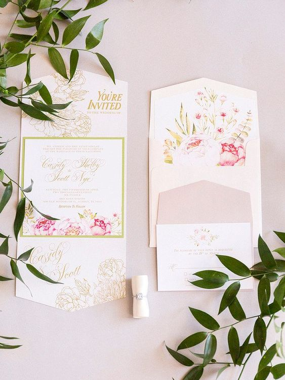 a beautiful wedding invitations suite with refined florals in pink and gold plus floral lining of the envelope is amazing
