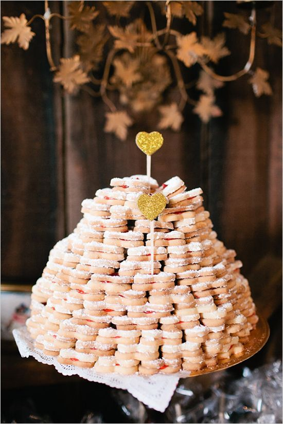 a heart-shaped stacked cookie wedding cake with gold glitter heart toppers is a lovely idea for a spring or summer wedding