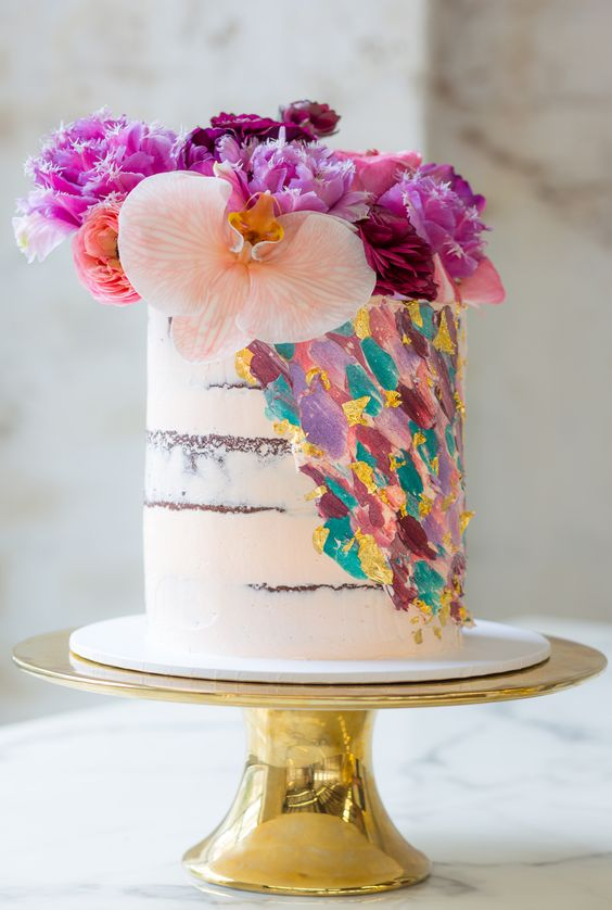 a naked wedding cake with colorful dimensional brushstrokes and super bright blooms on top is a lively and fun idea