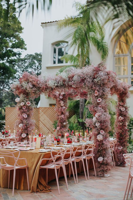 a pink baby's breath wedding arch with pink roses is a very pretty and cool idea to rock for your bold wedding