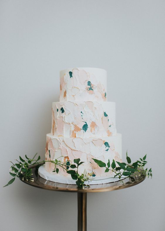 a modern wedding cake with pastel and teal brushstrokes is a fresh idea for a modern wedding and it looks non-boring