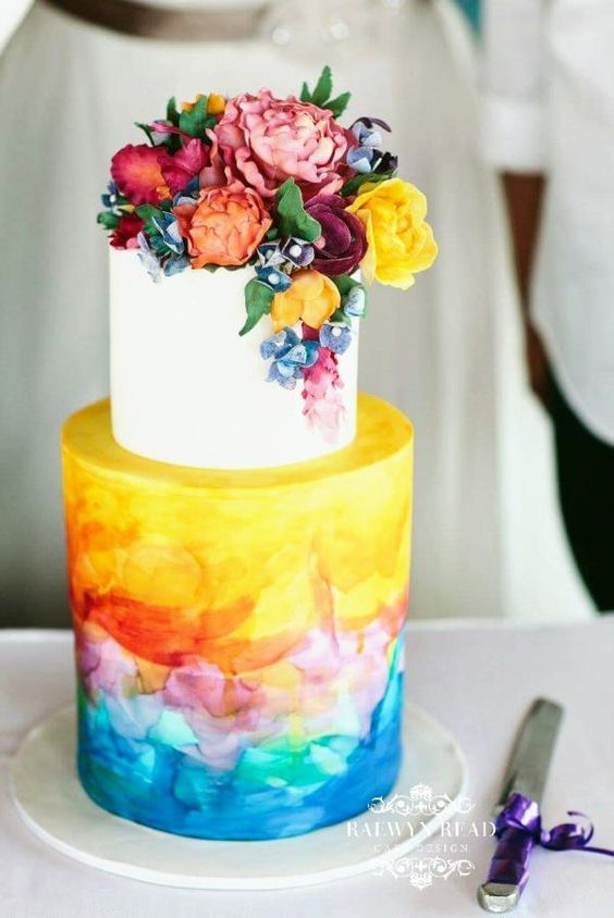 a super bold watercolor wedding cake with watercolors, bold fresh and sugar blooms on top is a fantastic idea to rock