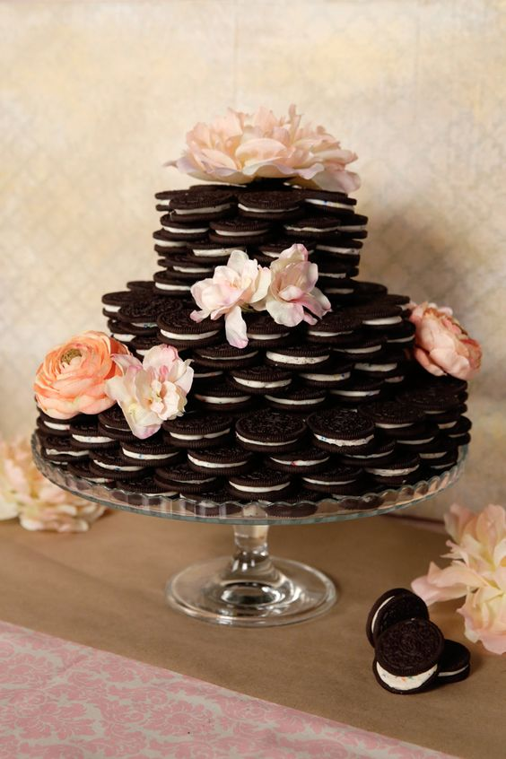a simple Oreo cookie wedding cake decorated with pink and peachy blooms is a lovely idea for a modern wedding