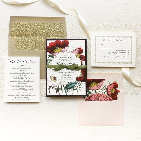 a bold floral wedding invitation suite with a gold envelope and glitter lining plus a blush envelope