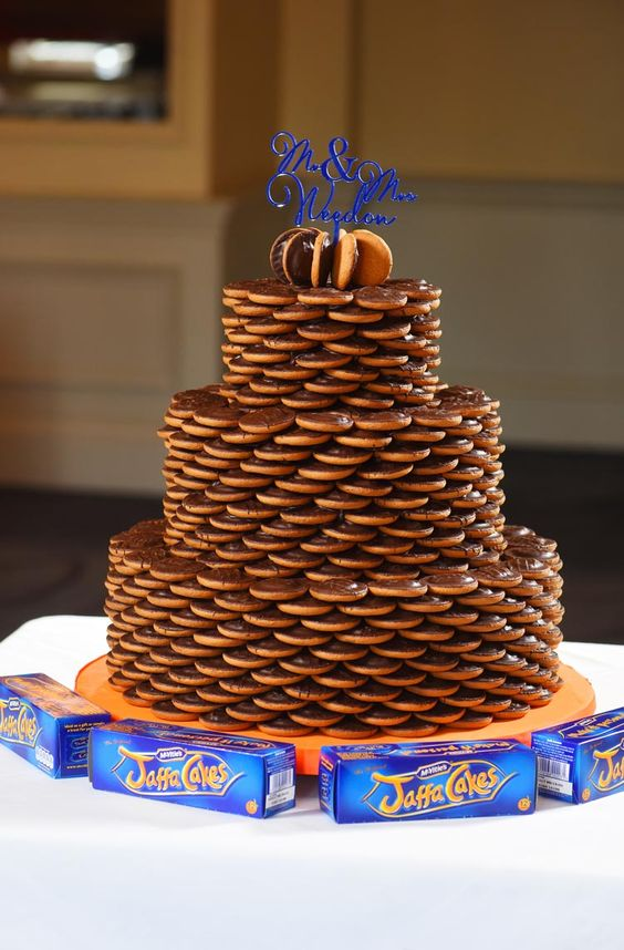 a stacked cookie wedding cake with a bold blue topper is a pretty and easy idea for a wedding