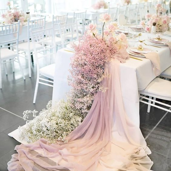 a romantic ombre baby's breath table runner with ombre fabric and light pink roses is very chic
