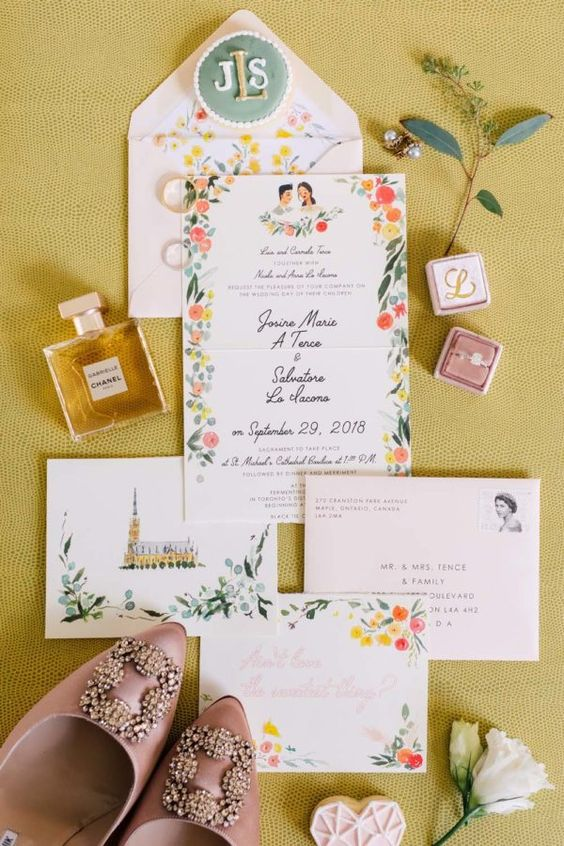 a bright and playful wedding invitation suite with floral prints in bold shades plus painting is super cool
