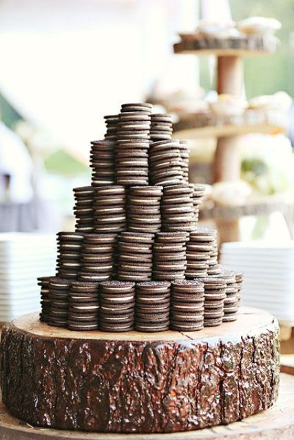 a wood slice with stacked Oreo cookies is a cool alternative to a usual wedding cake and it will save the budget