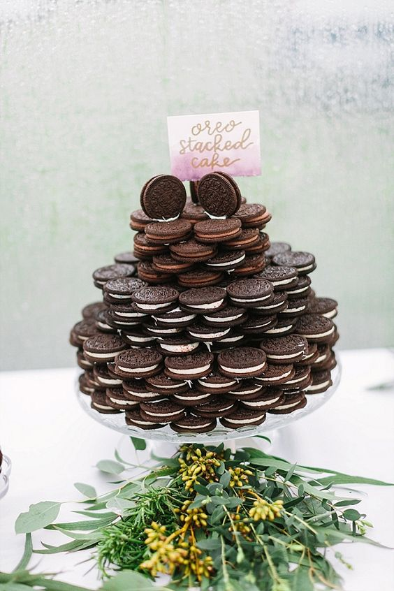an Oreo cookie stacked cake is a simple and pretty substitute to a usual wedding cake and it looks cool