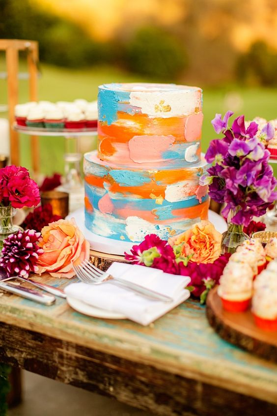 a super colorful brushstroke wedding cake for a bold summer wedding is a creative and fun idea
