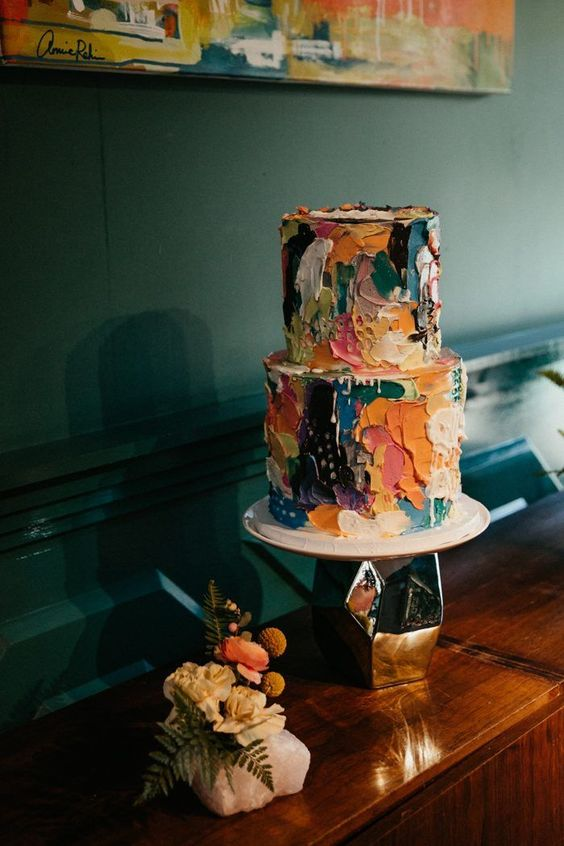 a super colorful brushstroke wedding cake with drip is a great idea for an artful wedding