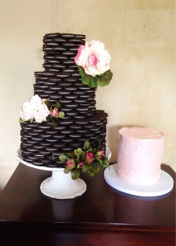 an Oreo cookie stacked wedding cake with fresh pink and blush blooms is a lovely idea to rock for any wedding