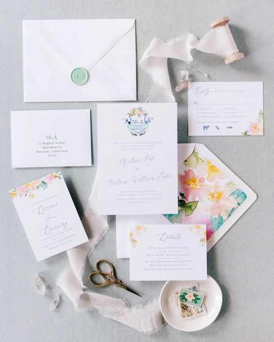a colorful watercolor wedding invitation suite with bold lining but white envelopes and pieces