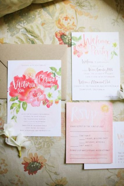a colorful wedding invitation suite with bold watercolor blooms, a pink piece and calligraphy for a relaxed summer wedding