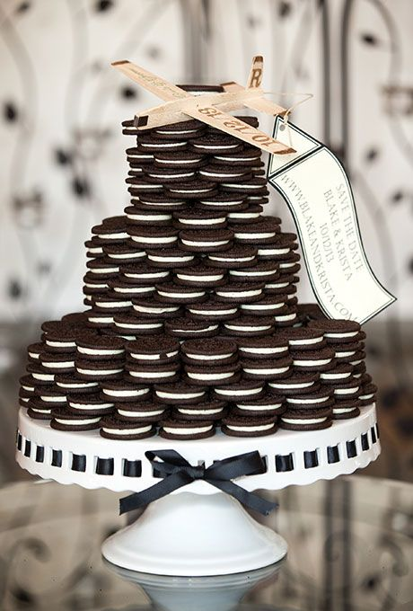 an Oreo cookie wedding cake topped with a plywood plane and a banner is a pretty and very simple idea to rock
