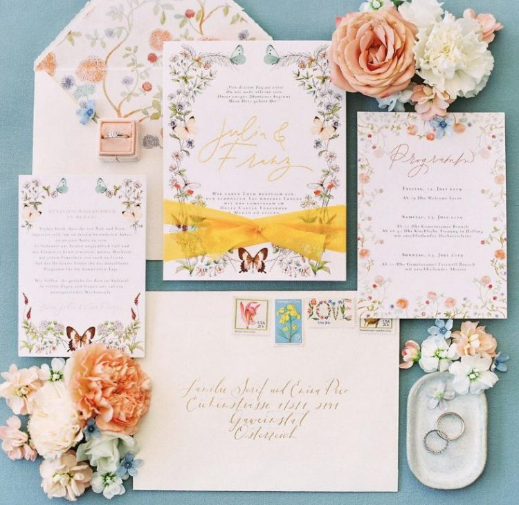 a fantastic floral invitation suite with bright wildflowers, bright ribbons and calligraphy is wow