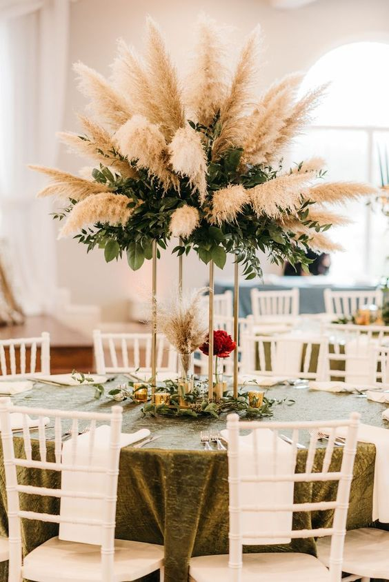 a dramatic wedding centerpiece of textural greenery and pampas grass is a pretty and bold idea for a modern wedding