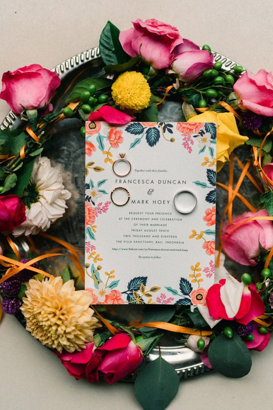 a super bold floral invitation suite in pink, orange and blue is a lovely idea for a colorful summer wedding