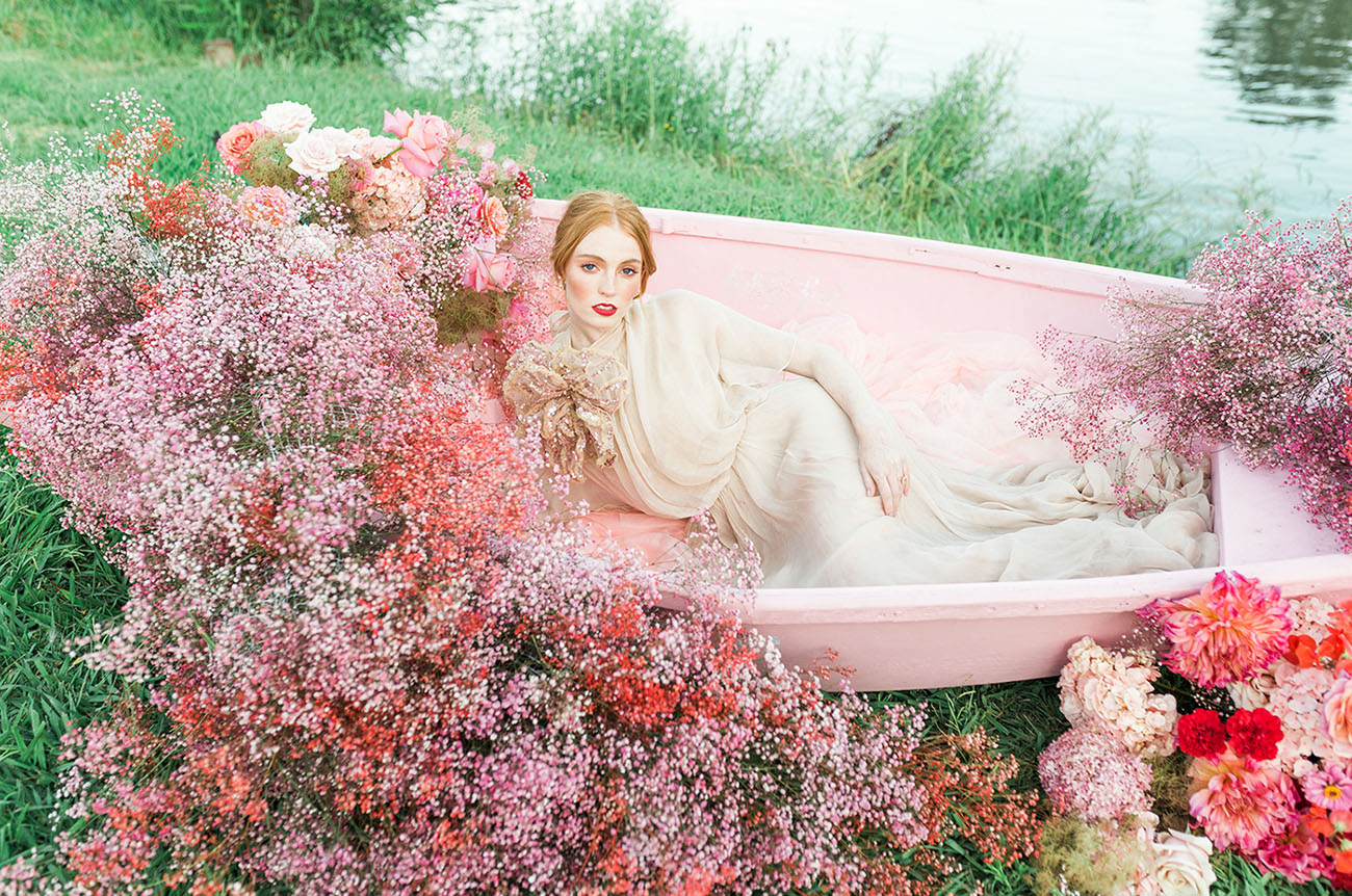 a pink boat decorated with red and pink baby's breath and red and pink roses for a bold look