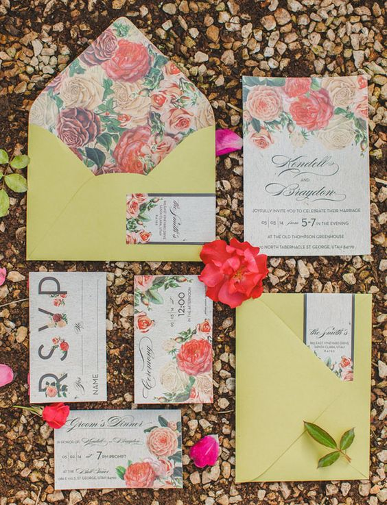 a super colorful floral wedding invitation suite with mustard envelopes and bold floral prints for a cheerful summer wedding