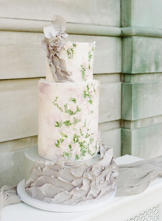 an impessionist art inspired brushstroke wedding cake with a floral tier and grey ruffle ones looks ethreal and beautiful