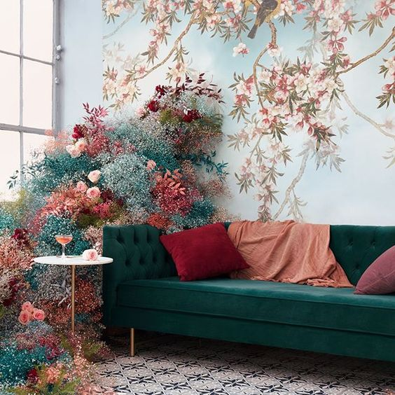 a beautiful wedding lounge decorated with blue, turquoise, pink and red baby's breath and leaves is a lovely idea