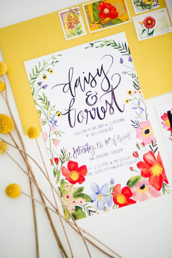 a yellow envelope and a bold wedding invitation with bright watercolor florals is a very cheerful and beautiful idea for summer