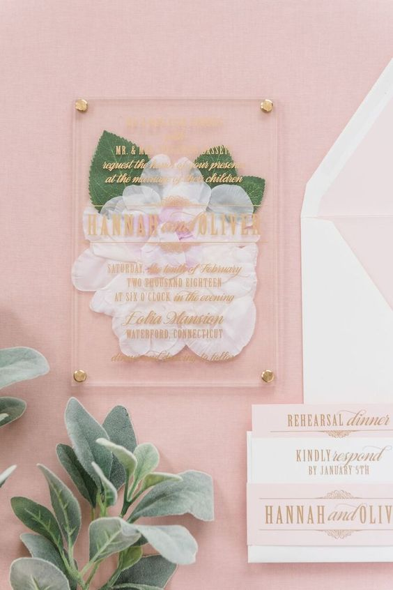 an acrylic wedding invitation with pressed blooms inside is very romantic and beautiful idea