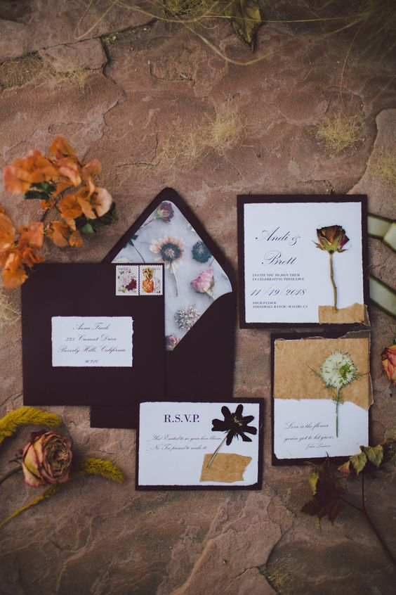 a bright wedding invitation suite with purple envelopes and floral lining, real dried blooms plus contrasting invites