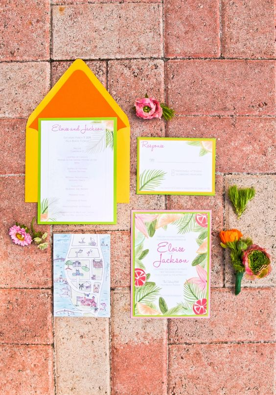 a bold tropical wedding invitation with a bright envelope, bright floral and botanical prints and a fun map is all cool