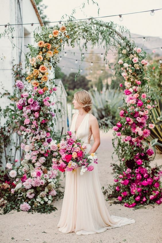 an ombre floral wedding arch