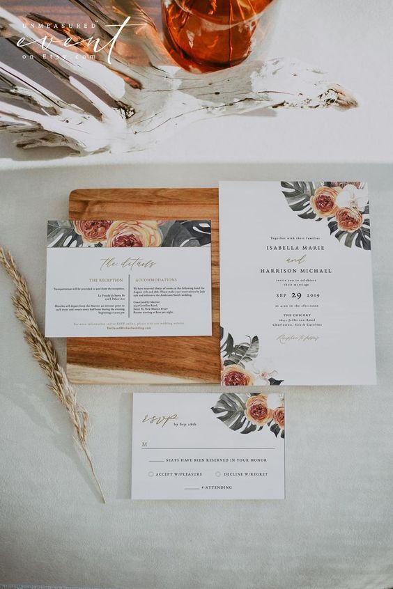 a burnt orange boho wedding invitation suite with tropical leaf and blooms prints is a stylish idea for an elegant wedding