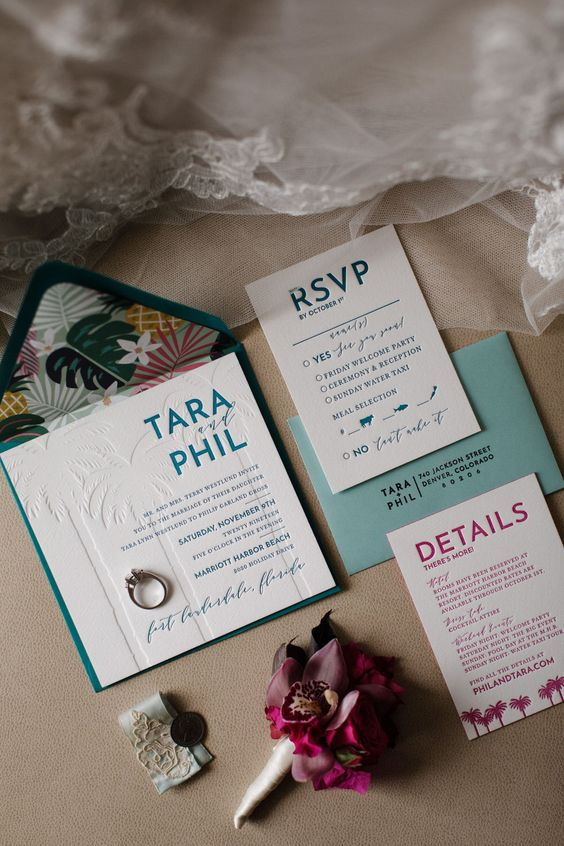 a chic tropical wedding invitation suite with teal and blue envelopes and colorful and white pressing is a fresh and bold idea
