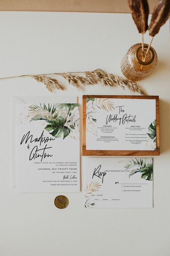 a chic tropical wedding invitation suite with tropical leaf prints, modern calligraphy and gold seals is pure elegance