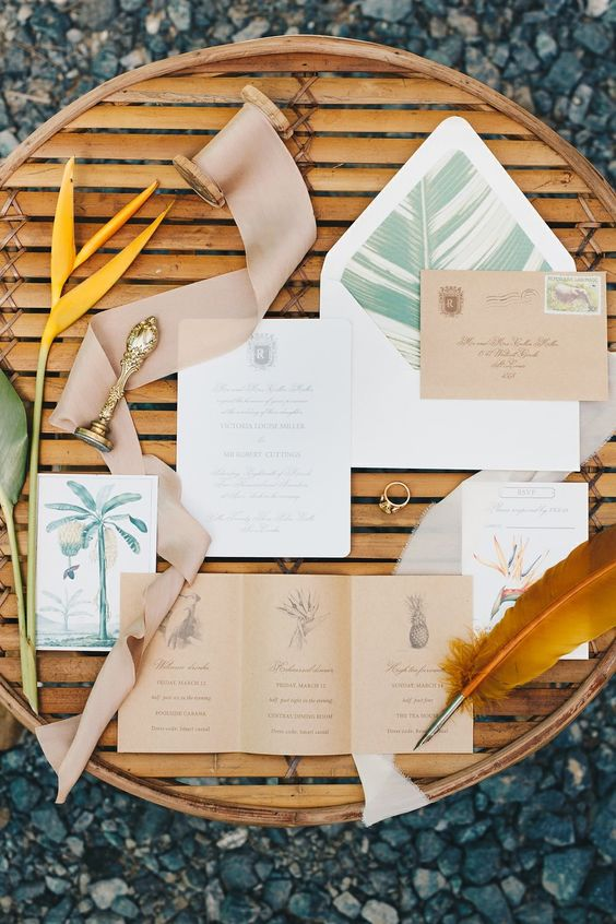 a colonial style wedding invitation suite with kraft paper, pale tree and leaf prints and seals is chic