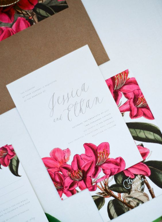 a colorful tropical wedding invitation suite with botanical and floral prints and calligraphy is a chic idea