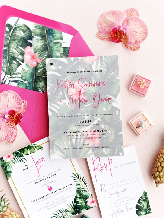 a colorful wedding invitation suite with a hot pink envelope, floral and botanical prints and bright lining for a modern tropical wedding