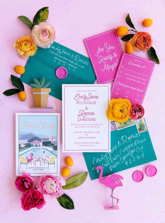 a fun and colorful green and hot pink wedding invitation suite with pink seals, flamingo prints is a fun idea for a mid-century wedding