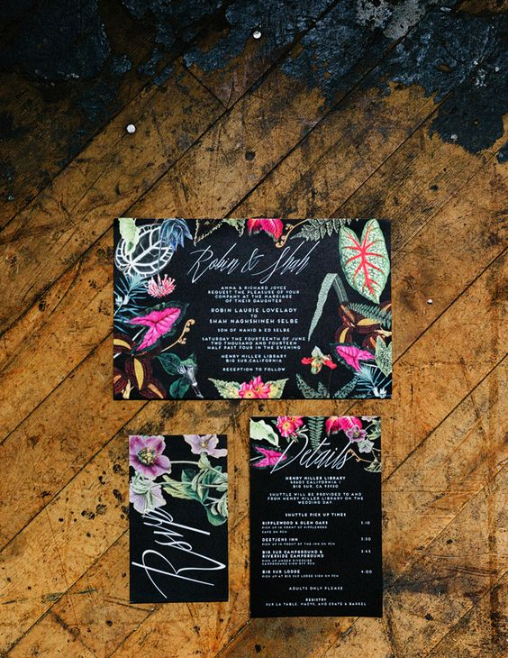 a moody wedding invitation suite with bold tropical floral prints is a very stylish idea for a modern tropical wedding