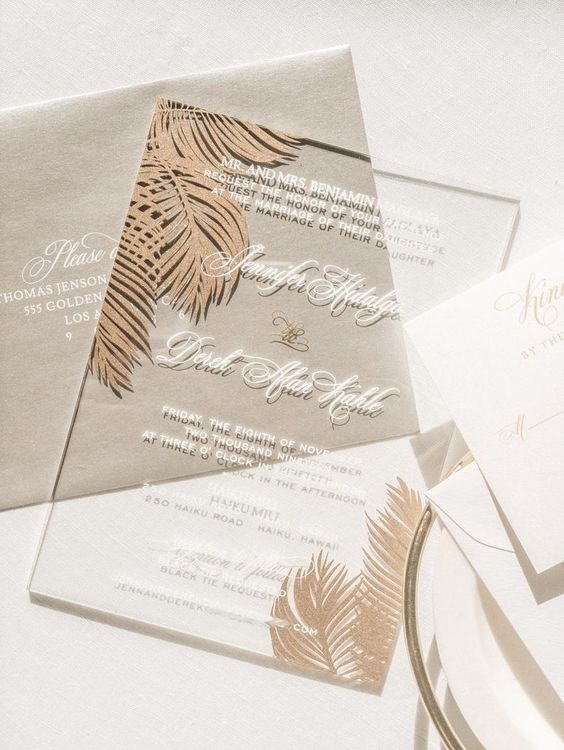 a neutral tropical wedding invitation suite with a grey envelope, an acrylic invite and gold glitter touches is very refined