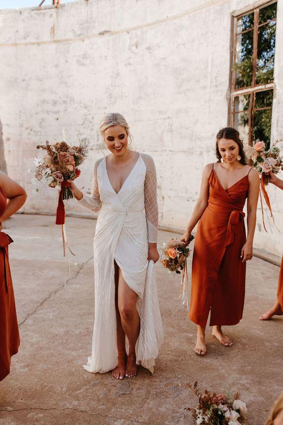 a pretty rust wrap midi bridesmaid dress with a wrapped bodice and a sash, on spaghetti straps is a comfy idea