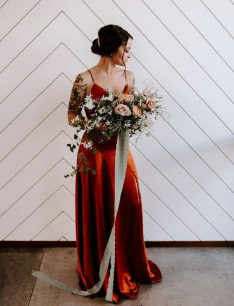 a refined burnt orange maxi slip bridesmaid dress with a train is ultimate elegance that will work for many wedding styles