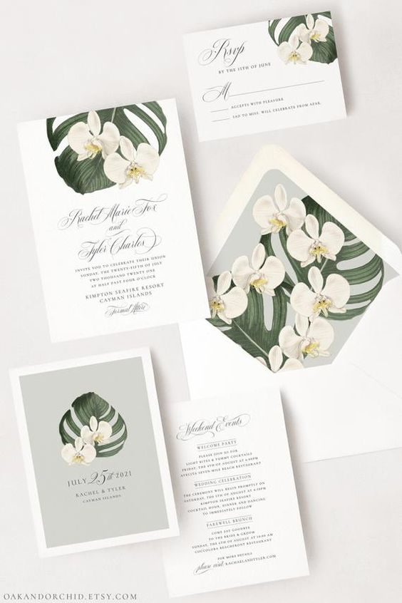 a romantic tropical wedding invitation suite with white orchid and monstera leaf prints is a very elegant option