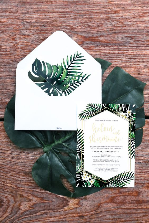 a stylish botanical wedding invitation suite done in neutrals but with tropical prints is a cool idea