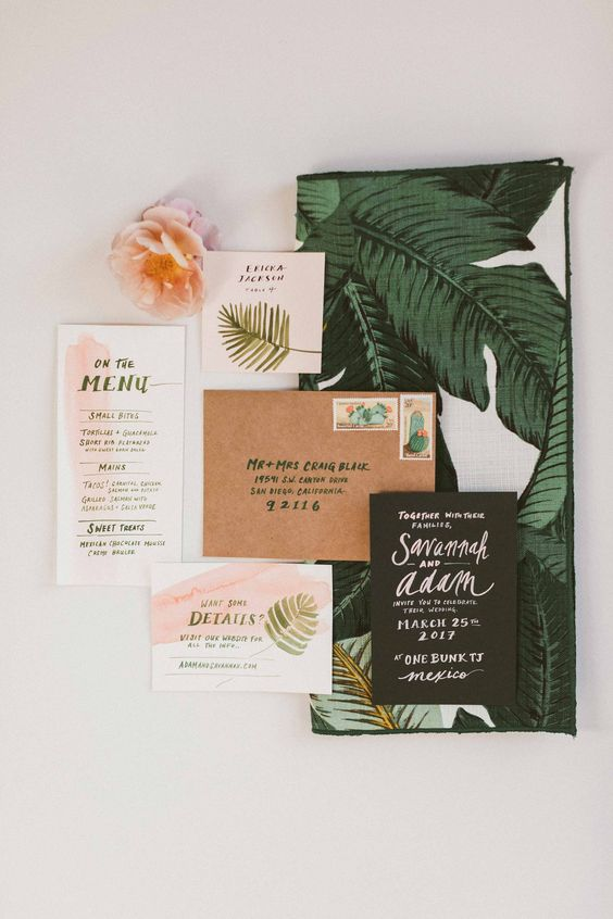 a stylish vintage wedding invitation suite with watercolor blush touches, leaf prints and cool calligraphy