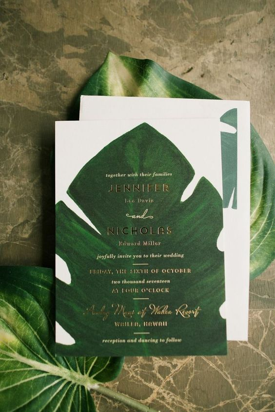 a tropical wedding invitation suite with monstera leaf prints and gold letters is pure elegance without looking much